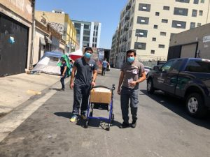 LACHC staff distributes supplies on Skid Row